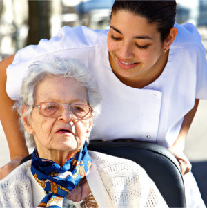Personel helping an old woman